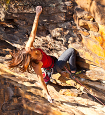 "Elaina Arenz-Smith climbing ""Mister Fantasy"" 11c at the ""Endless Wall,"" New River Gorge, West Virginia."